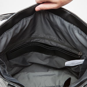 kgiq_convertible_tote_holding_int1